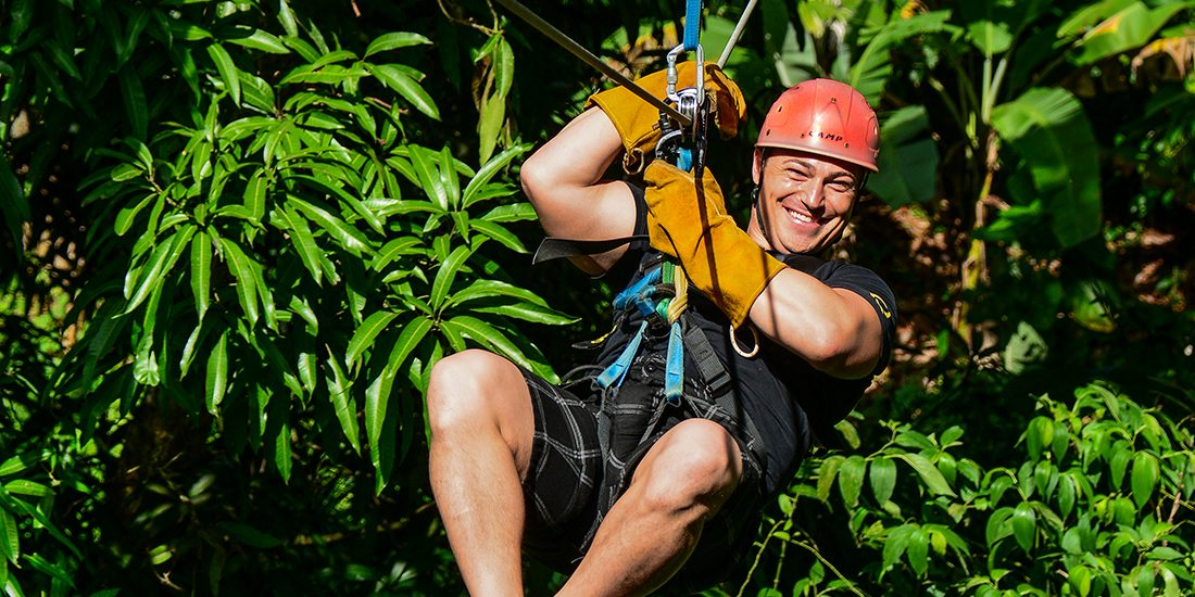 A man enjoying while doing a canopy excursion