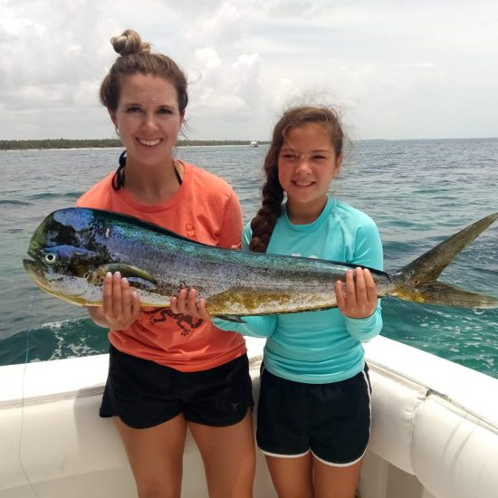Mother and daughter holding a big fish